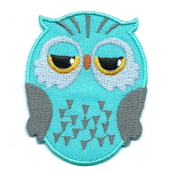 Mint green iron on embroidered owl patch with black and yellow eyes.