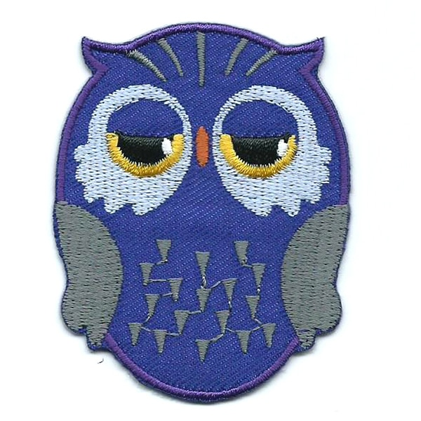 Purple iron on embroidered owl patch with black and yellow eyes.