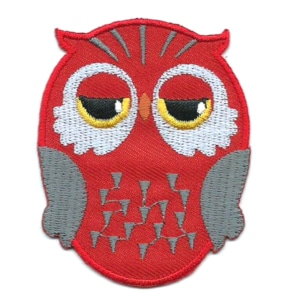 Red iron on embroidered owl patch with black and yellow eyes.