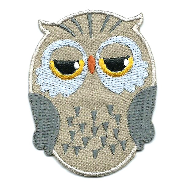 Brown iron on embroidered owl patch with black and yellow eyes.