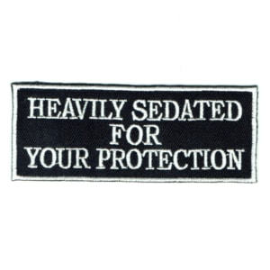 Iron on embroidered rectangular heavily sedated for your protection patch