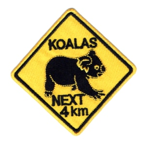 Iron on embroidered yellow koalas next 4km road sign patch