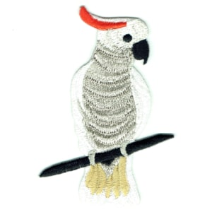 Iron on embroidered patch of a citron crested cockatoo on a branch