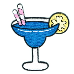 Iron on embroidered patch of a blue cocktail drink with pink straws and yellow lemon slice
