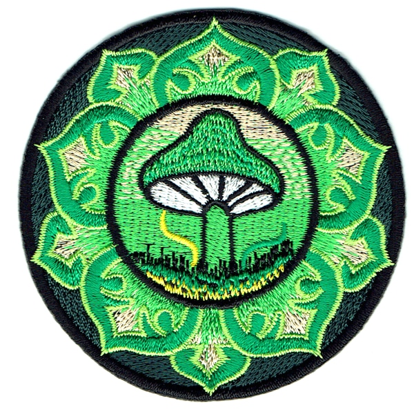 Round iron on embroidered patch of a lotus style emblem with a mushroom in the centre.