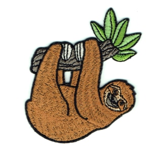 Cute embroidered iron on patch of a brown sloth hanging on a tree branch