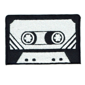 Iron on embroidered black and white cassette tape patch.
