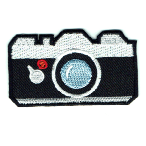Classic style black and white iron on camera patch with light blue embroidered lens
