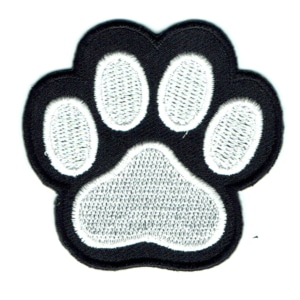 Animal paw print patch embroidered in black and white with iron on backing