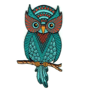 Iron on embroidered wise green owl patch on a branch