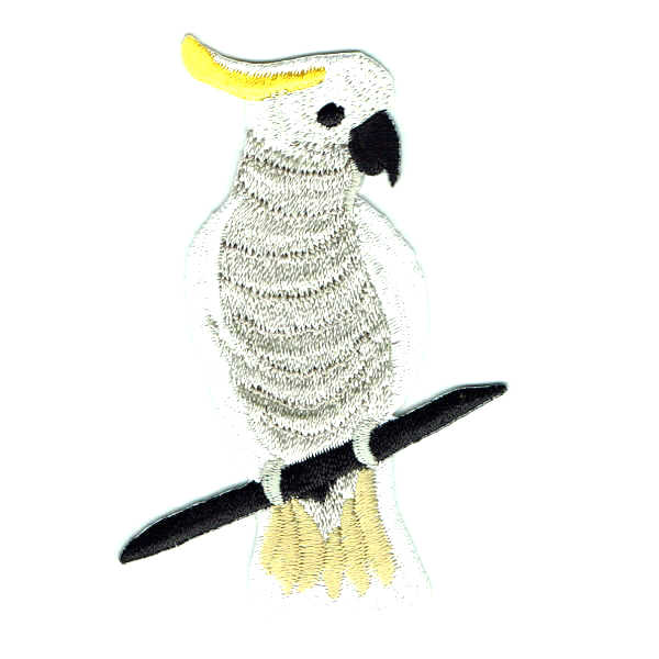 Embroidered patch of a sulphur crested cockatoo sitting on a tree branch