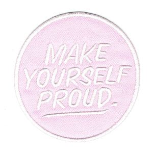 Round Iron On Patch Pink in colour with the words make yourself proud embroidered