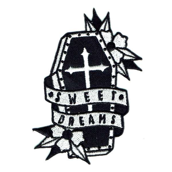 Black coffin iron on patch with the words sweet dreams embroidered around it.