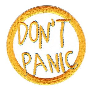 Round Iron On Patch With Don't Panic Embroidered in Yellow